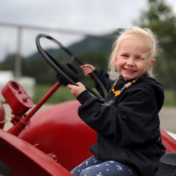 little girl on tractor, D Dutchmen Dairy, Sicamous BC